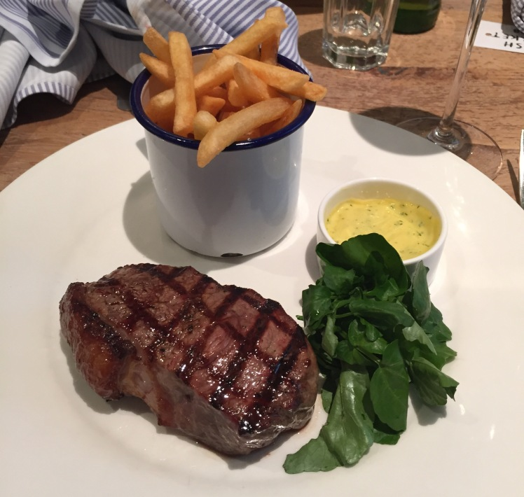 char grilled minute steak, fries with bearnaise sauce